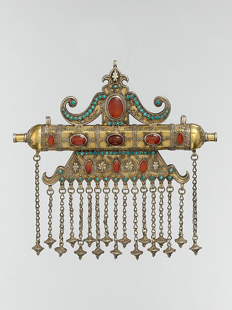 Triangular Amulet Holder, Silver; fire-gilded, with stamped beading, silver shot, decorative wire, gilt and silver applied decoration, loop-in-loop chains, cone-shaped pendants, slightly domed and cabochon carnelians, and turquoise beads