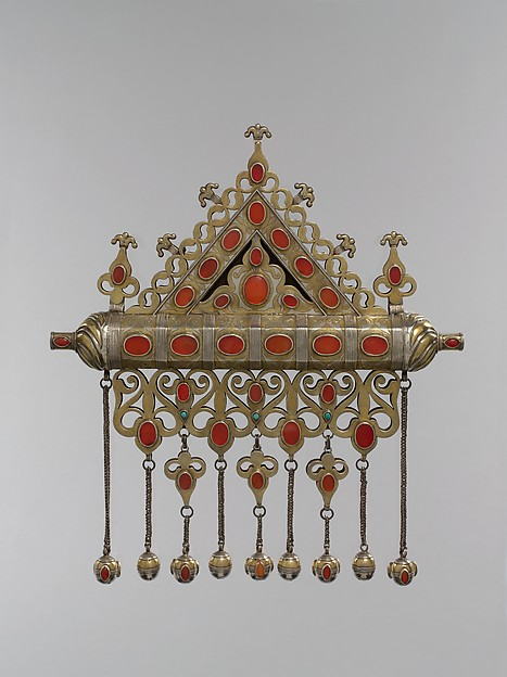 Amulet Holder, Silver; fire-gilded and chased, with decorative wire, ram's-head terminals, openwork, slightly domed cabochon and table-cut carnelians, turquoise beads, wire chains, and spherical bells