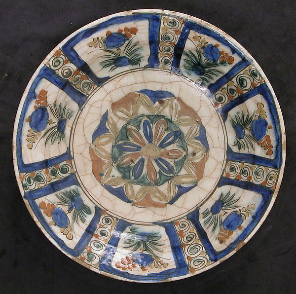 Dish, Stonepaste; underglaze painted in black, blue, and green with red and yellow slips