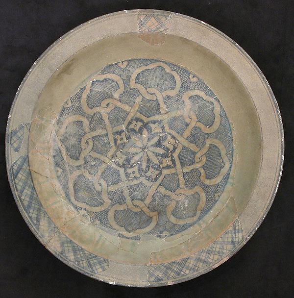 Dish, Earthenware; white slip with monochrome slip decoration under a transparent glaze