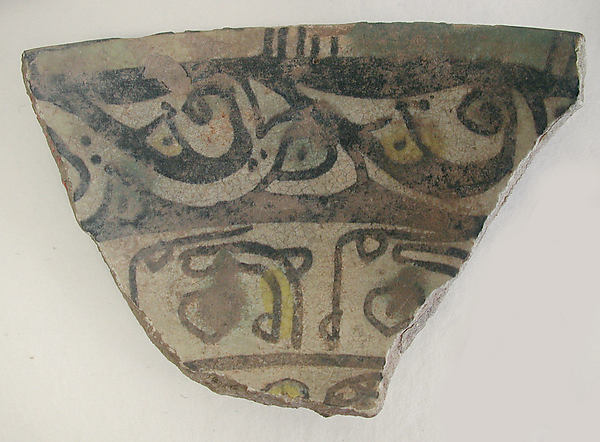 Fragment of a Bowl, Earthenware; painted in black slip and polychrome pigments under transparent colorless glaze (buffware)