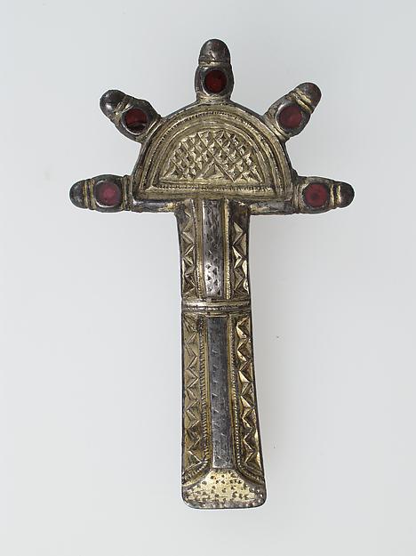 Bow Brooch, Silver-gilt, niello, garnet, iron pin, Frankish
