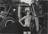 Donald York, Jr., Standing Beside His Father's Wrecker on July 4th, Millerton, New York, Mark Goodman (American, born 1946), Gelatin silver print