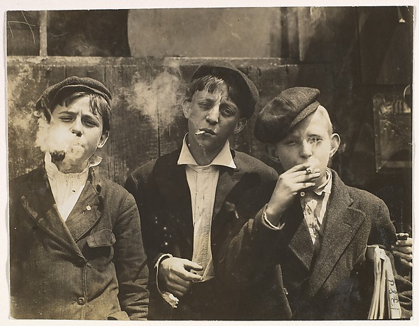 11:00 A.M. Monday, May 9th, 1910. Newsies at Skeeter's Branch, Jefferson near Franklin. They were all smoking. Location: St. Louis, Missouri., Lewis Hine (American, 1874–1940), Gelatin silver print
