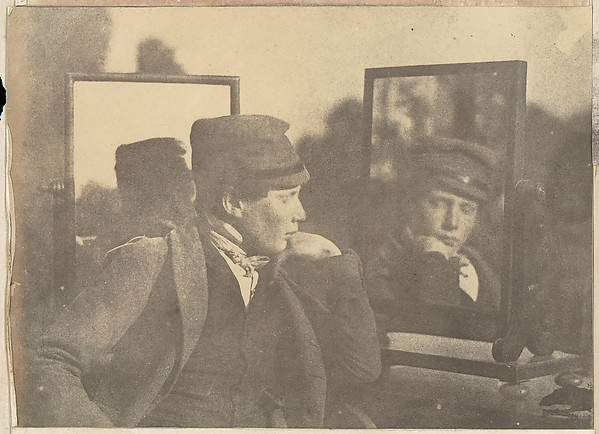 [Boy in Profile, Face Shown Frontally in Mirror], Unknown (British), Salted paper print from paper negative