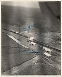 [Aerial View of Train Being Bombed], Unknown (American), Gelatin silver print
