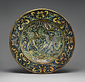Dish (piatto); The story of Hercules: the gods called upon Hercules to help them defend Olympus against the attack of the Giants, sons of Uranus and Gaea (Heaven and Earth), Maiolica (tin-glazed earthenware), Italian, Deruta
