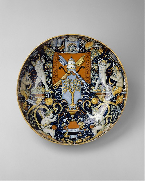 Bowl with the Arms of Pope Julius II and the Manzoli of Bologna surrounded by putti, cornucopiae, satyrs, dolphins, birds, etc., workshop of Giovanni Maria Vasaro (Italian (Castel Durante), active early 16th century), Maiolica (tin-glazed earthenware), Italian, Castel Durante