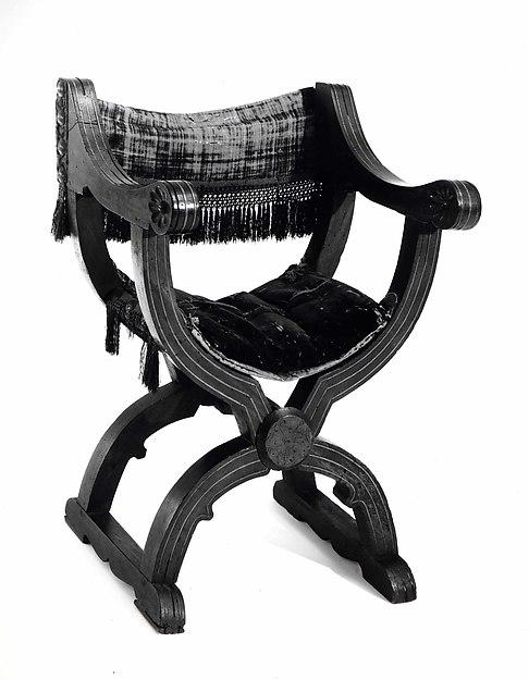 Hip-joint armchair (Dantesca type), Walnut, carved; embroidery, silk velvet, metal., Italian